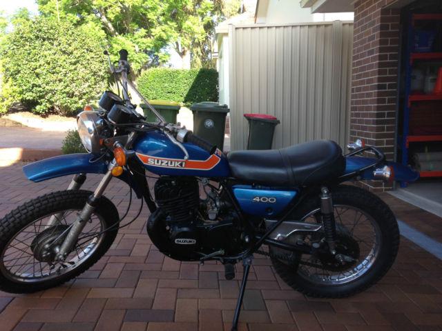 Suzuki TS400 1974 plus NOS tail-light, gear levers, seat