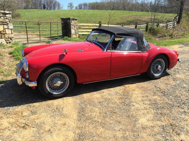 "Beautiful red convertible with 15"" wire wheels, mechanically restored with new 1"