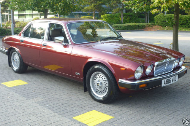 1984 JAGUAR SOVEREIGN 4.2 AUTO CRANBERRY RED BISCUIT LEATHER. LOTS SPENT
